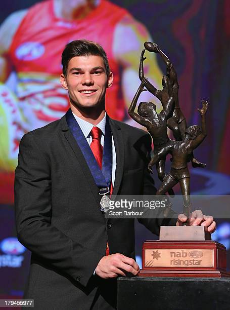 Jaeger O'Meara of the Gold Coast Suns poses with the trophy after winning the 2013 Ron Evans Medal NAB Rising Star Award as the best young player in...