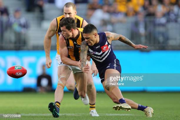 Jaeger O'Meara of the Hawks and Michael Walters of the Dockers contest for the ball during the round 19 AFL match between the Fremantle Dockers and...