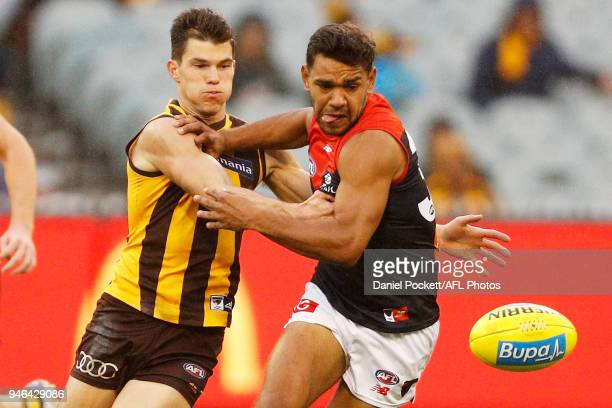 Jaeger O'Meara of the Hawks and Neville Jetta of the Demons contest the ball during the round four AFL match between the Hawthorn Hawks and the...