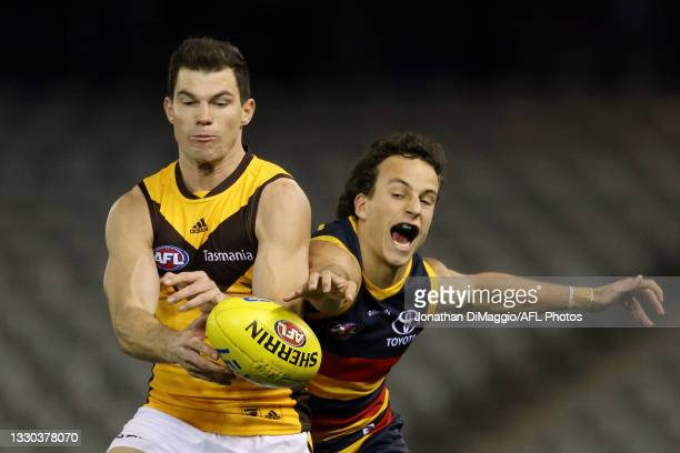 Jaeger O'Meara of the Hawks and Will Hamill of the Crows contest for the ball during the round 20 AFL match between Adelaide Crows and Hawthorn Hawks...