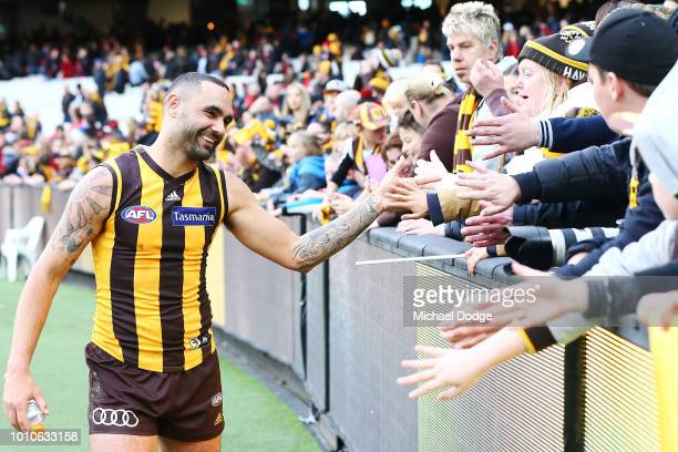 Jaeger O'Meara of the Hawks celebrates the win with fans during the round 20 AFL match between the Hawthorn Hawks and the Essendon Bombers at...