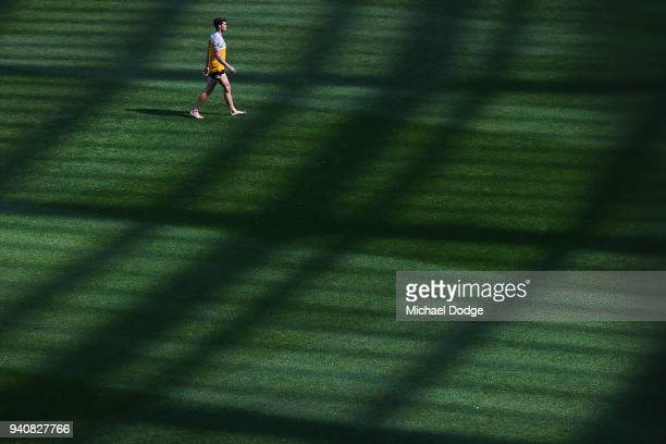 Jaeger O'Meara of the Hawks checks the surface before warm up during the round two AFL match between the Geelong Cats and the Hawthorn Hawks at...