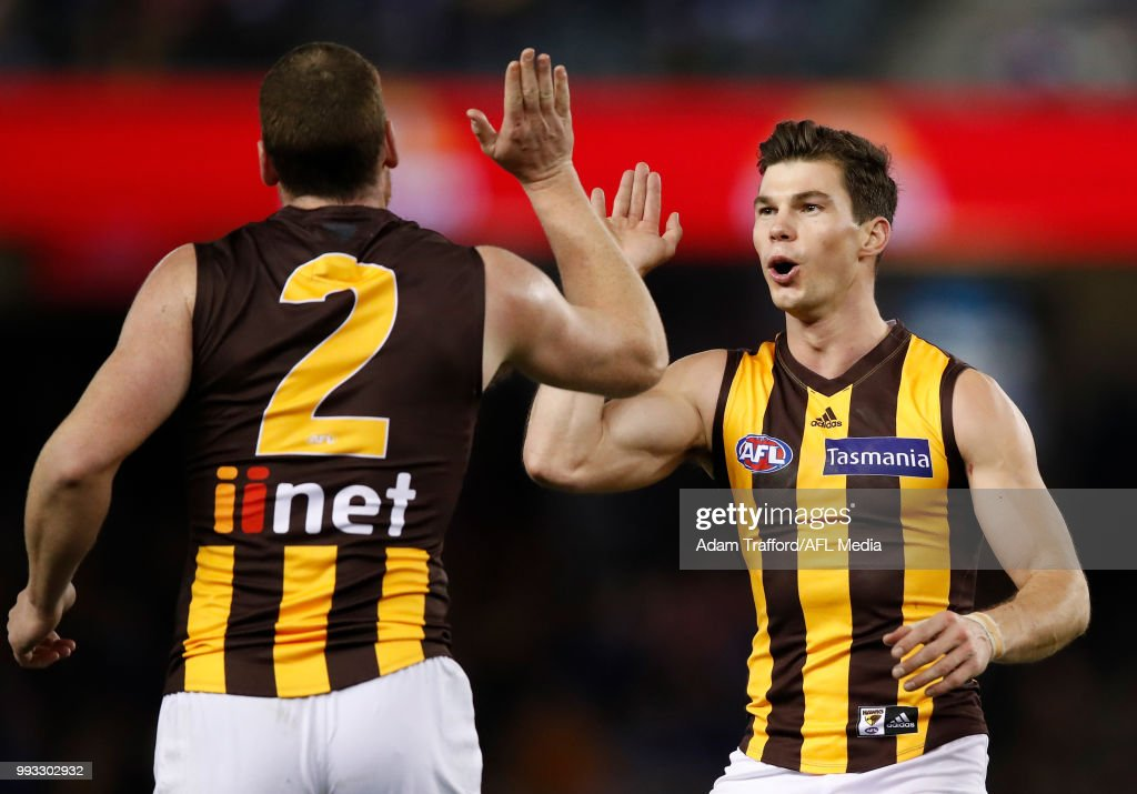 Jaeger O'Meara of the Hawks (right) congratulates Jarryd Roughead of the Hawks on a goal during the 2018 AFL round 16 match between the Western Bulldogs and the Hawthorn Hawks at Etihad Stadium on July 07, 2018 in Melbourne, Australia.