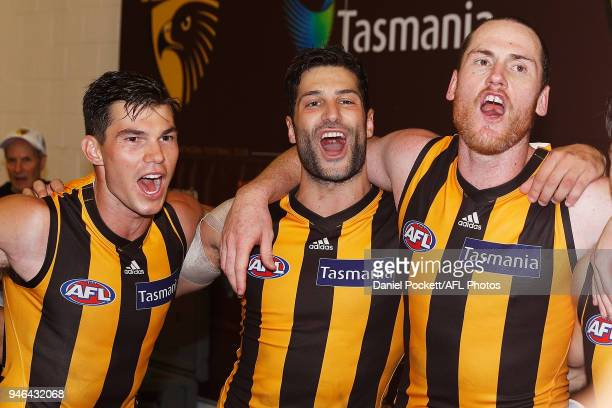 Jaeger O'Meara of the Hawks David Mirra of the Hawks and Jarryd Roughead of the Hawks sing the team song after winning the round four AFL match...