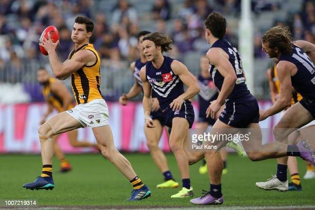 Jaeger O'Meara of the Hawks looks to pass the ball during the round 19 AFL match between the Fremantle Dockers and the Hawthorn Hawks at Optus...