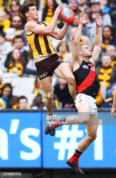Jaeger O'Meara of the Hawks marks the ball against David Zaharakis of the Bombers during the round 20 AFL match between the Hawthorn Hawks and the...