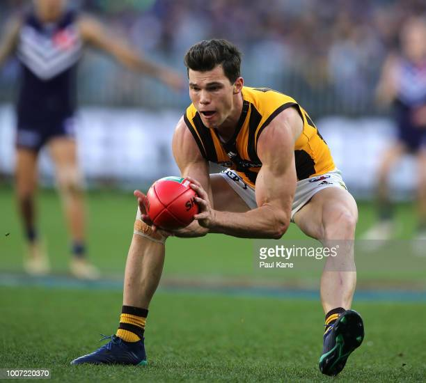 Jaeger O'Meara of the Hawks marks the ball during the round 19 AFL match between the Fremantle Dockers and the Hawthorn Hawks at Optus Stadium on...