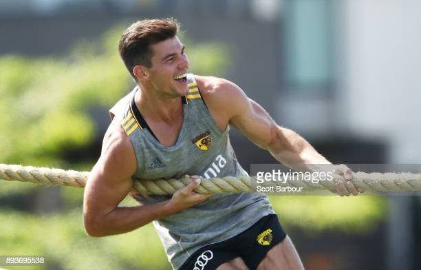 Jaeger O'Meara of the Hawks pulls during a tug of war competition against teammates during a Hawthorn Hawks AFL training session at Waverley Park on...