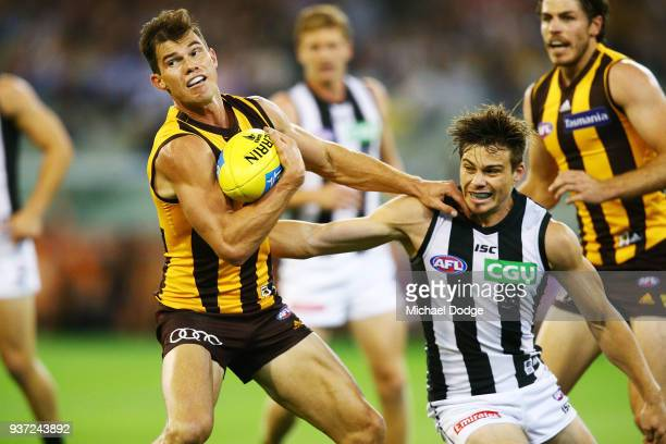 Jaeger O'Meara of the Hawks pushes away Josh Thomas of the Magpies during the round one AFL match between the Hawthorn Hawks and the Collingwood...