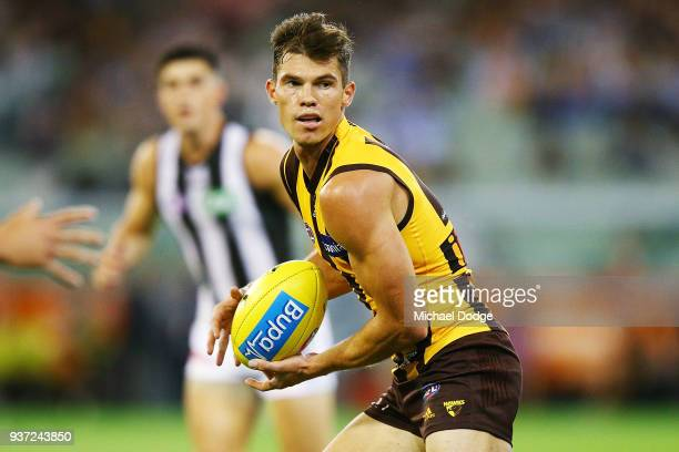 Jaeger O'Meara of the Hawks runs the ball during the round one AFL match between the Hawthorn Hawks and the Collingwood Magpies at Melbourne Cricket...
