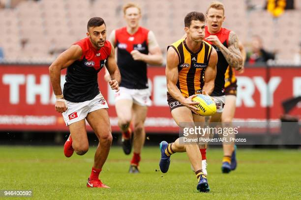 Jaeger O'Meara of the Hawks runs with the ball during the round four AFL match between the Hawthorn Hawks and the Melbourne Demons at Melbourne...