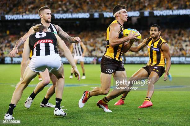 Jaeger O'Meara of the Hawks runs with the ball during the round one AFL match between the Hawthorn Hawks and the Collingwood Magpies at Melbourne...