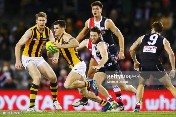 Jaeger O'Meara of the Hawks runs with the ball from Jack Steven of the Saints during the round 22 AFL match between the St Kilda Saints and Hawthorn...