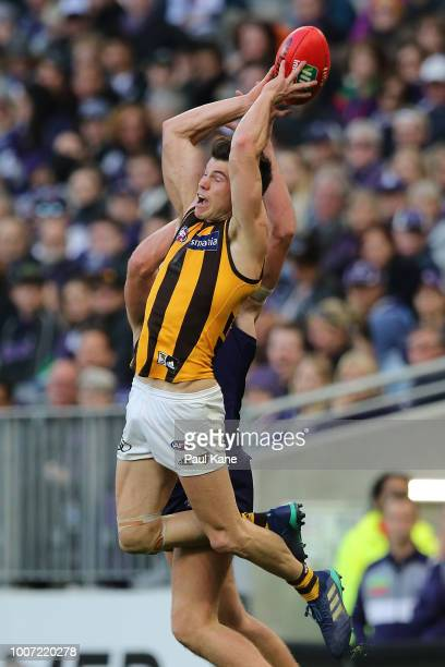 Jaeger O'Meara of the Hawks sets for a mark during the round 19 AFL match between the Fremantle Dockers and the Hawthorn Hawks at Optus Stadium on...