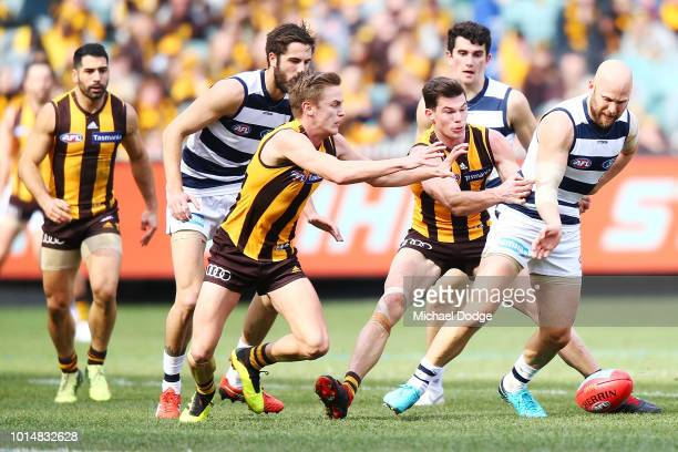 Jaeger O'Meara of the Hawks tackles Gary Ablett of the Cats during the round 21 AFL match between the Hawthorn Hawks and the Geelong Cats at...