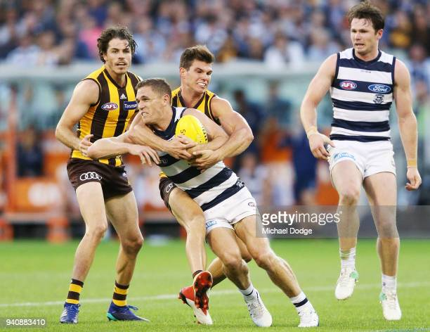 Jaeger O'Meara of the Hawks tackles high Joel Selwood of the Cats during the round two AFL match between the Geelong Cats and the Hawthorn Hawks at...