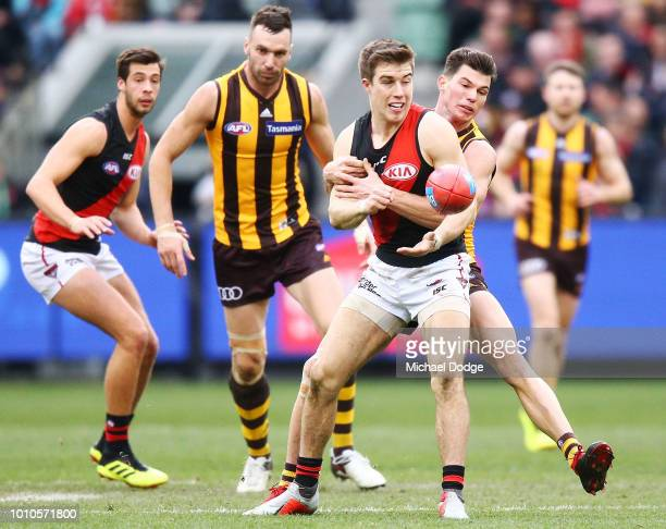 Jaeger O'Meara of the Hawks tackles Zach Merrett of the Bombers during the round 20 AFL match between the Hawthorn Hawks and the Essendon Bombers at...