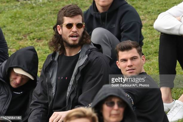 Jaeger O'Meara of the Hawthorn Hawks and Ben Stratton of the Hawks watch from the crowd during the VFL Semi Final match between Geelong and Box Hill...