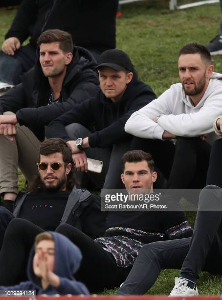 Jaeger O'Meara of the Hawthorn Hawks Ben Stratton of the Hawks Taylor Duryea of the Hawks and Jack Gunston of the Hawks watch from the crowd during...