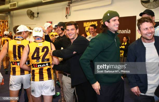 Jaeger O'Meara of the Hawthorn Hawks congratulates Box Hill players in the rooms after winning the VFL Grand Final match between Casey and Box Hill...