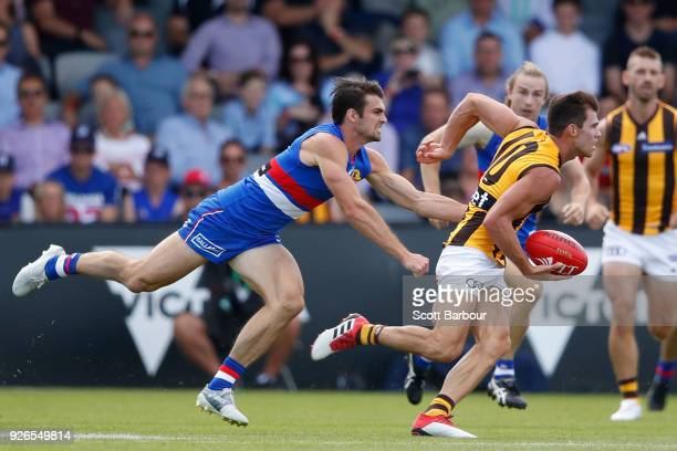 Jaeger O'Meara of the Hawthorn Hawks is tackled by Easton Wood of the Bulldogs during the AFL JLT Community Series match between the Western Bulldogs...