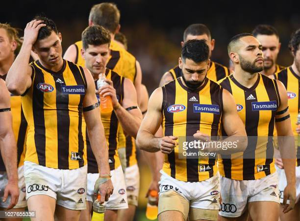 Jaeger O'Meara Paul Puopolo and Jarman Impey of the Hawks look dejected after losing the AFL First Qualifying Final match between the Richmond Tigers...