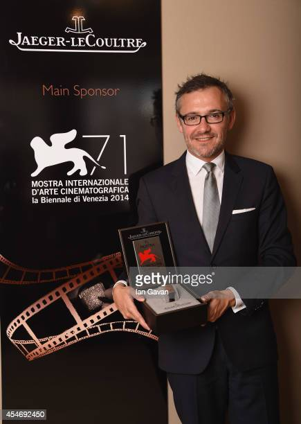 JaegerLeCoultre Communication Director Laurent Vinay poses with the 'JaegerLeCoultre Glory To The Filmmaker 2014 Award' honoring James Franco in...