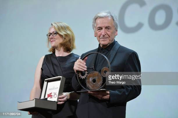 Jaeger-LeCoultre International Public Relations Director Isabelle Gervais presents Director Costa-Gavras with the Jaeger-LeCoultre Glory To The...