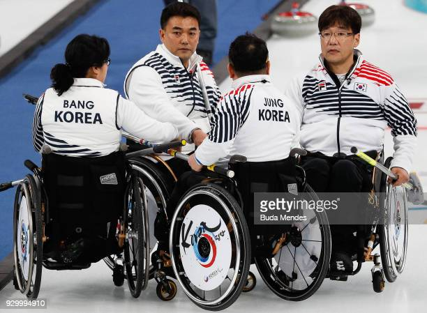 Jaegoan Cha of Korea talks with his teammates in the Wheelchair Curling Round Robin Session 01 during day one of the PyeongChang 2018 Paralympic...