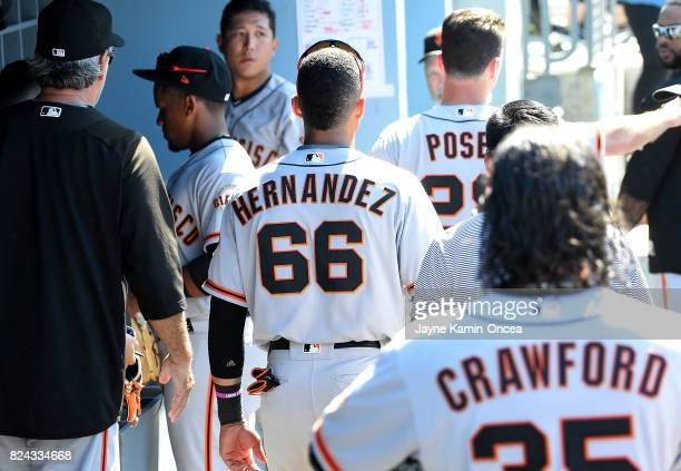 JaeGyun Hwang Buster Posey Gorkys Hernandez and Brandon Crawford of the San Francisco Giants leave the dugout after the final out against the Los...