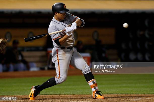 JaeGyun Hwang of the San Francisco Giants at bat against the Oakland Athletics during the sixth inning at the Oakland Coliseum on July 31 2017 in...