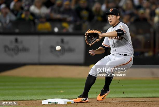 JaeGyun Hwang of the San Francisco Giants fields a ground ball off the bat of Khris Davis of the Oakland Athletics in the bottom of the fifth inning...
