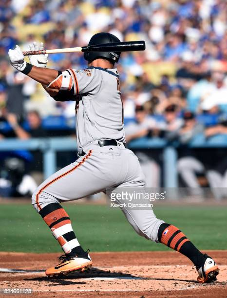 JaeGyun Hwang of the San Francisco Giants hits against pitcher HyunJin Ryu of the Los Angeles Dodgers during the second inning at Dodger Stadium...