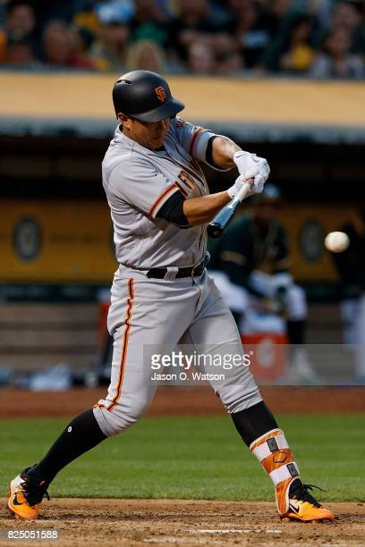 JaeGyun Hwang of the San Francisco Giants hits an RBI single against the Oakland Athletics during the fourth inning at the Oakland Coliseum on July...