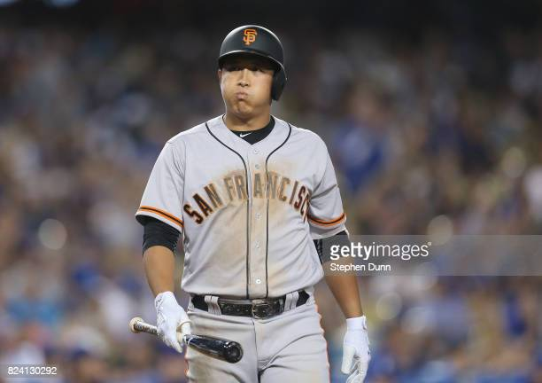 Jaegyun Hwang of the San Francisco Giants reacts after striking out looking for the second out of the ninth inning against closer Kenley Jnsen of the...