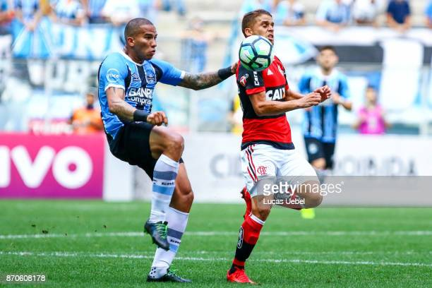 Jael of Gremio battles for the ball against Cuellar of Flamengo during the match Gremio v Flamengo as part of Brasileirao Series A 2017 at Arena do...