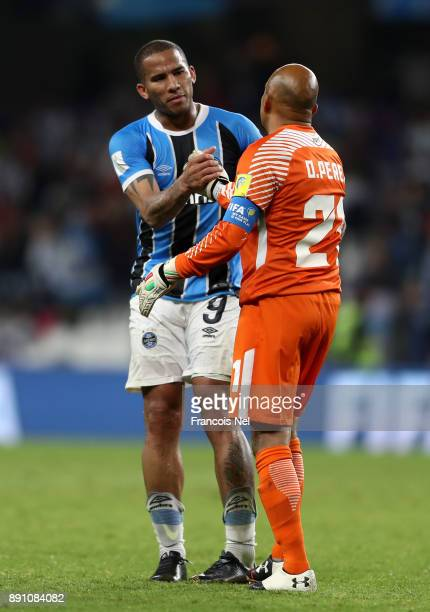 Jael of Gremio shakes hands with Oscar Perez of CF Pachuca during the FIFA Club World Cup UAE 2017 semifinal match between Gremio FBPA and CF Pachuca...