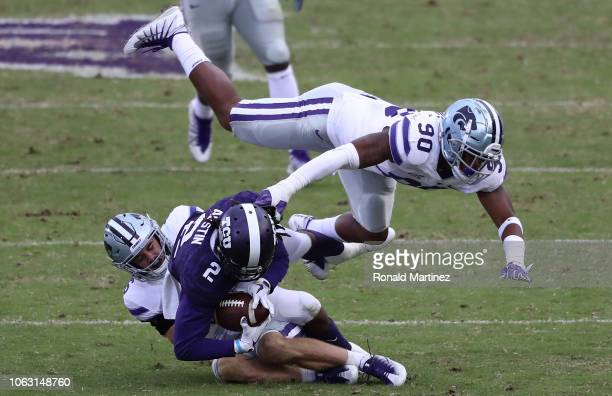 Jaelan Austin of the TCU Horned Frogs is tackled by Johnathan Durham and Bronson Massie of the Kansas State Wildcats in the second half at Amon G...