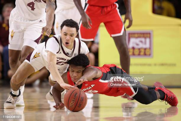 Jaelen House of the Arizona State Sun Devils and Sahvir Wheeler of the Georgia Bulldogs dive for a loose ball during the second half of the NCAAB...