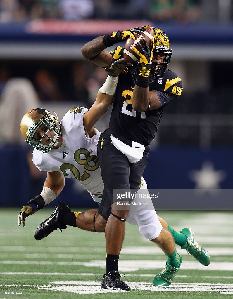 Jaelen Strong #21 of the Arizona State Sun Devils makes a pass reception against Austin Collinsworth #28 of the Notre Dame Fighting Irish at at Cowboys Stadium on October 5, 2013 in Arlington, Texas.