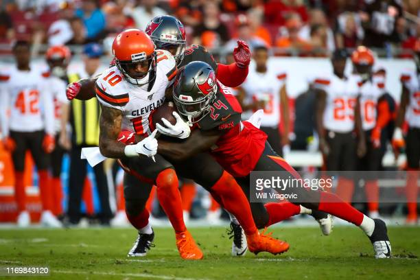 Jaelen Strong of the Cleveland Browns gets dragged down by Kentrell Brice of the Tampa Bay Buccaneers in the first quarter of the preseason game at...