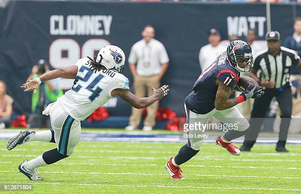 Jaelen Strong of the Houston Texans avoids Daimion Stafford of the Tennessee Titans at NRG Stadium on October 2 2016 in Houston Texas