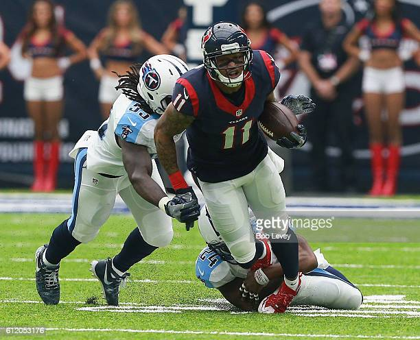 Jaelen Strong of the Houston Texans breaks a tackle by Sean Spence of the Tennessee Titans at NRG Stadium on October 2 2016 in Houston Texas