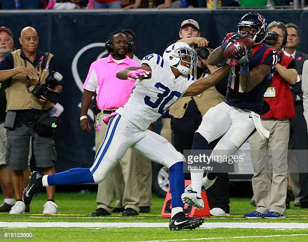 Jaelen Strong of the Houston Texans makes a catch over Rashaan Melvin of the Indianapolis Colts in the fourth quarter at NRG Stadium on October 16...