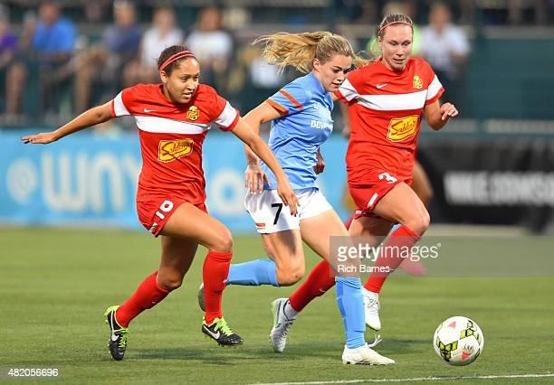Jaelene Hinkle of the Western New York Flash Kealia Ohai of the Houston Dash and Whitney Engen of the Western New York Flash battle for a loose ball...