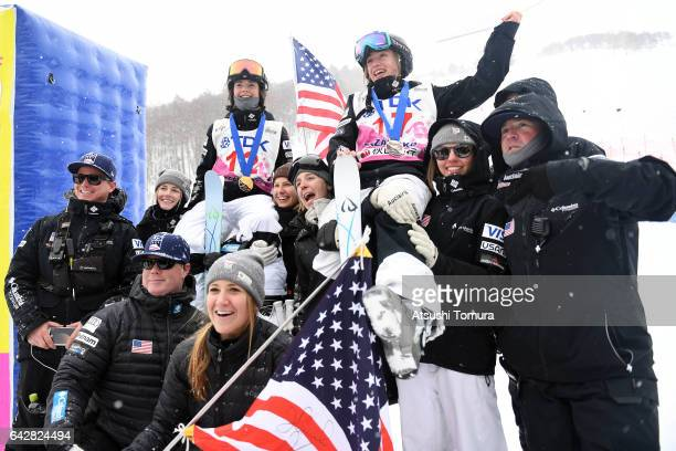 Jaelin Kauf and Olivia Giaccio of the USA pose with their team mates after the ladies dual moguls during 2017 FIS Freestyle Ski World Cup Tazawako In...