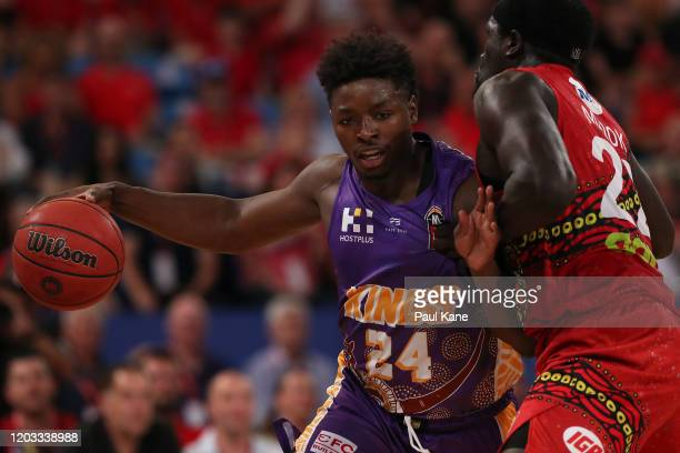 Jae'Sean Tate of the Kings controls the ball against Majok Majok of the Wildcats during the round 18 NBL match between the Perth Wildcats and the...