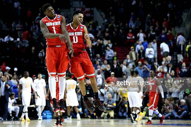 Jae'Sean Tate of the Ohio State Buckeyes and D'Angelo Russell of the Ohio State Buckeyes celebrate after defeating the Virginia Commonwealth Rams in...