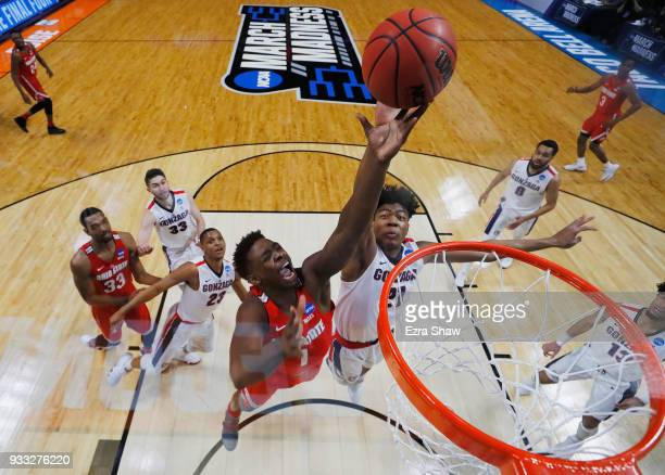 Jae'Sean Tate of the Ohio State Buckeyes battles for a rebound with Rui Hachimura of the Gonzaga Bulldogs in the second round of the 2018 NCAA Men's...