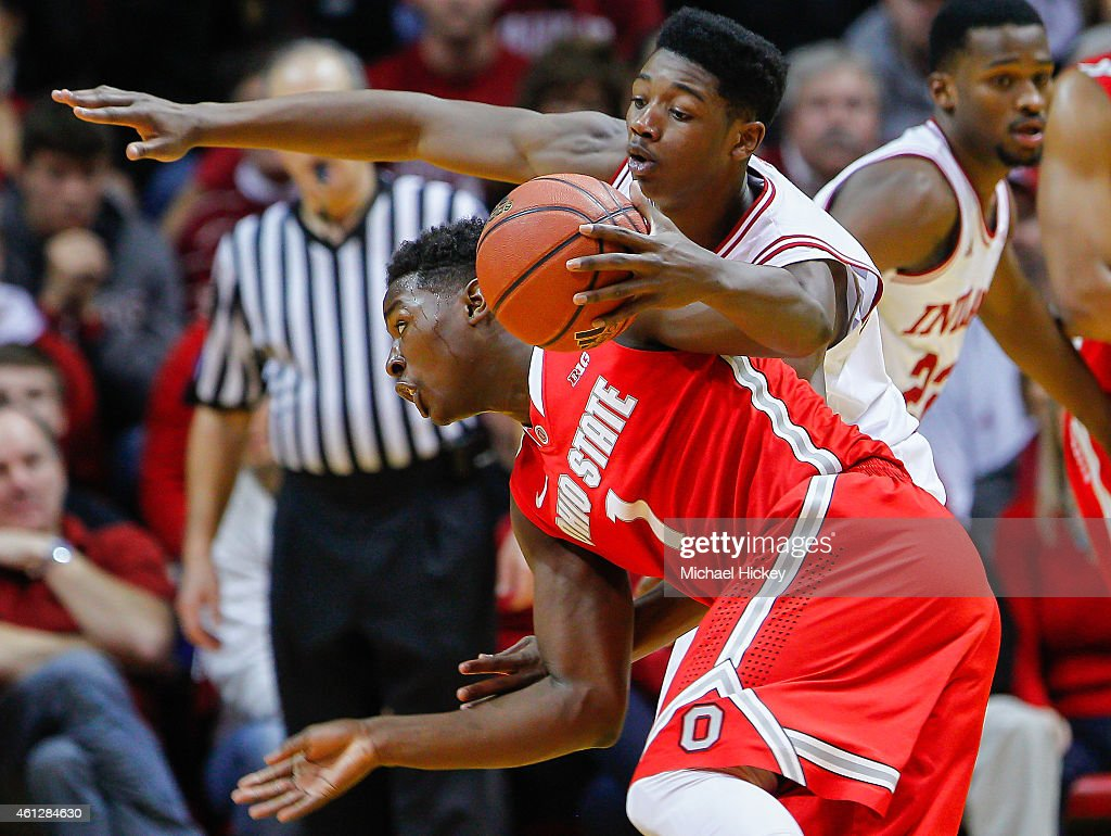 Jae'Sean Tate #1 of the Ohio State Buckeyes dribbles the ball as Emmitt Holt #25 of the Indiana Hoosiers defends from up top at Assembly Hall on January 10, 2015 in Bloomington, Indiana. Indiana defeated Ohio State 69-66.